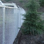 330-commercial chain link w/barbed wire