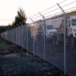 329-commercial chain link w/barbed wire