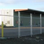 328-commercial chain link w/barbed wire