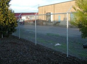 327-commercial chain link w/barbed wire