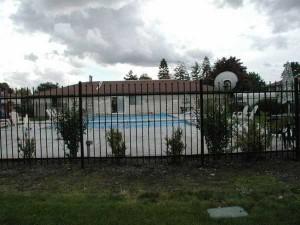 302-COM-ornamental iron pool enclosure, Riverview Place Apts.