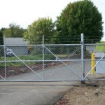 289-COM. Security gate w/barbed wire & gate operator
