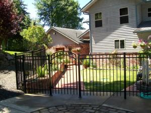 201 Design A-3 Ornamental Iron fence with custom gate, Newport, Oregon