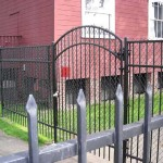 94 Ornamental iron fence and gate with chain link