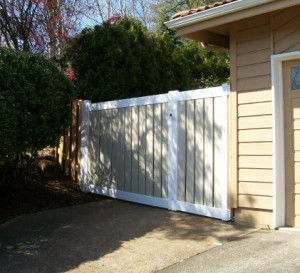 70 Vinyl & wood fence with walk gate